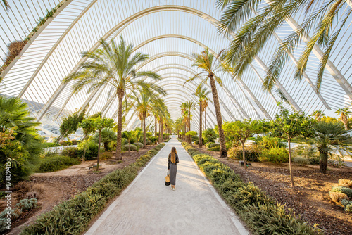 View on the modern park with woman walking in Valencia city, Spain