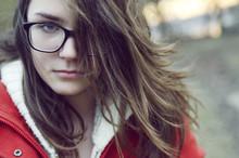 Teenage Girl In Red Coat Near ...