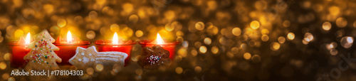 Four red Advent candles with christmas cookie. Fotobehang