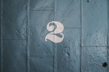 The Number 2 On An Old Metal Door.