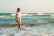 Girl With Long Hair on the background of the sea sunset