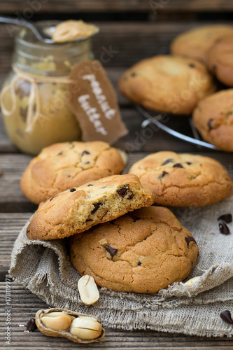 Tuinposter Koekjes Peanut butter cookies with chocolate chips on wooden background
