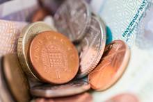 Close-up Of British Coins And Banknotes