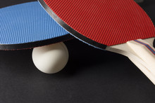 Red And Blue Ping Pong Paddles...