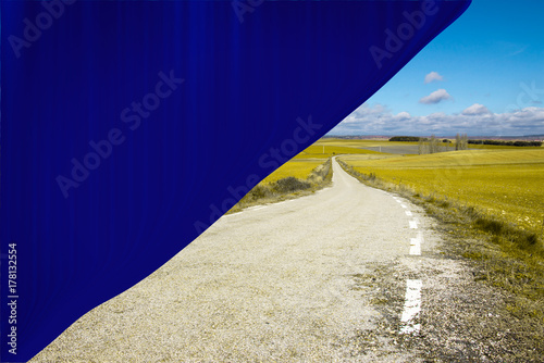 Rural road in soria behind a blue backdrop