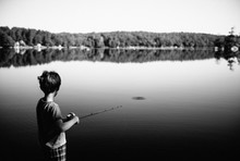 Boy Casts His Fishing Pole Int...