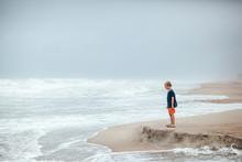 Boy On The Beach As A Hurricane Approaches