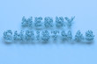 Merry Christmas words from blue balls on blue background