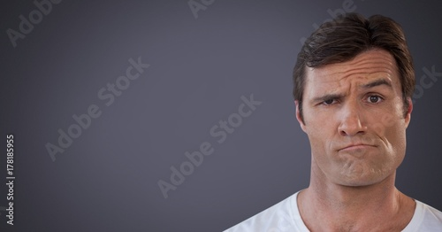Man looking confused and indecisive with purple background