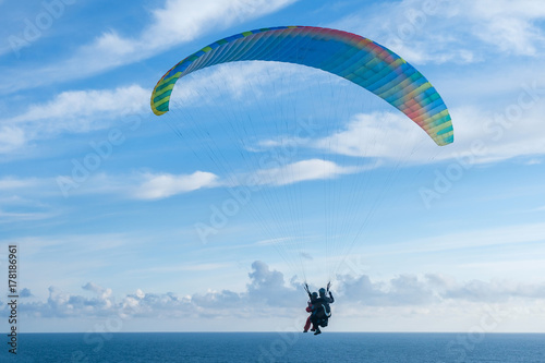 Fotografie, Obraz  Flying a tandem paraglider over the sea with views of the horizon