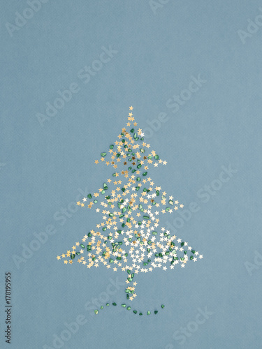 Sparkling christmas tree made of gold stars sequins and green shiny sparkling christmas tree made of gold stars sequins and green shiny pebbles on blue holiday m4hsunfo