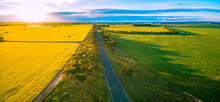Aerial Panorama Of Rural Road Passing Through Agricultural Land In Australian Countryside At Sunset