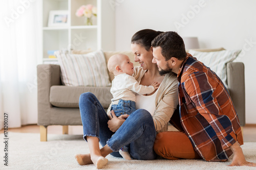 Obraz happy family with baby having fun at home - fototapety do salonu