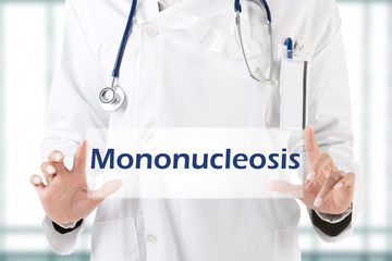 Female Doctor Holding Sign with mononucleosis written on it