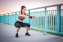 Young Athletic Woman Doing Squ...