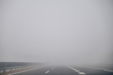 Highway In Foggy Time