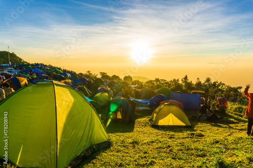 Camping tent on the hill sunrise time colourful sky