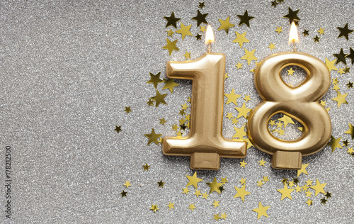 Number 18 gold celebration candle on star and glitter background Canvas Print