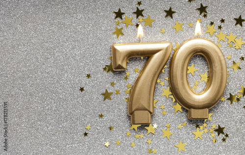 Fotografie, Obraz Number 70 gold celebration candle on star and glitter background