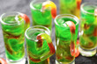 green Halloween jello shots with gummy worms