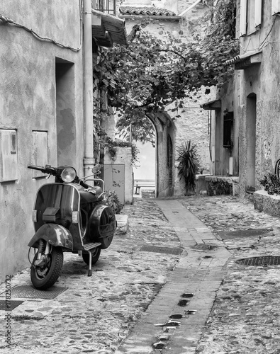 Foto op Canvas Scooter Old narrow street in the in France.