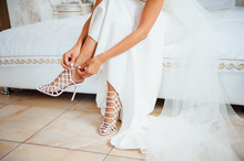 Bride Is Putting On Her Shoes For The Wedding Day