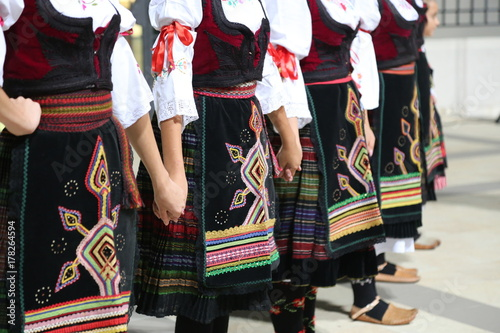 Serbian girls in traditional costume dancing Wallpaper Mural