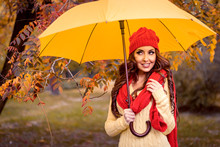 Happy Woman With Umbrella Walk...