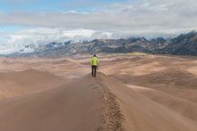 A Hiker Traverses Star Dune In...