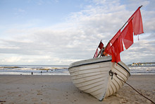 Fishing Boat With Red Flags At...