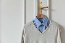 Shirt And Sweater Hanged On The Door