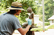 artist applying patina to sculpture