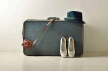 White Flats ,old Retro Camera And Hat Lean On Suitcase