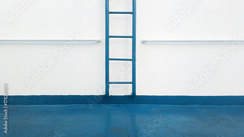 blue leather and white wall composition