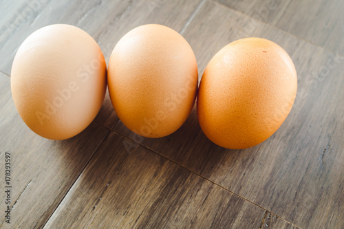 Brown Eggs on a Wooden Bamboo Background