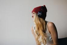 Pretty Blond Woman In A Beanie...