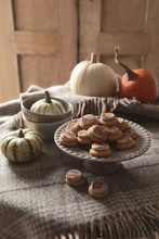 Little Pumpkins Cookies On Tray With Pumpkins And Gourds