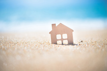 The symbol of the house standing on the seashore