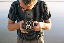 Man Taking A Photo With An Old Camera