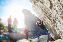 Female Rock Climber Climbs On ...
