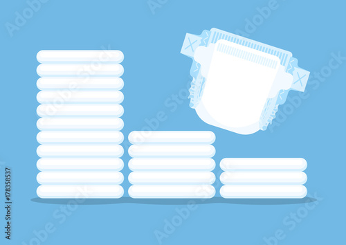 Tableau sur Toile Diaper and stack of diapers on blue background