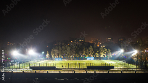 Spoed Foto op Canvas Stadion stadium at night floodlights Shine on the grass