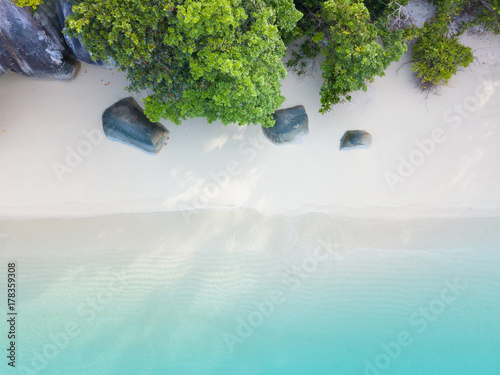 Valokuva  Aerial view or top view of beautiful beach with emerald water