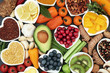 canvas print picture - Health food for fitness concept with fruit, vegetables, pulses, herbs, spices, nuts, grains and pulses. High in anthocyanins, antioxidants, smart carbohydrates, omega 3,  minerals and vitamins.