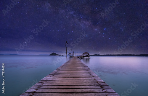 Foto op Plexiglas Nacht night view of ocean wood dock and milkyway on sky