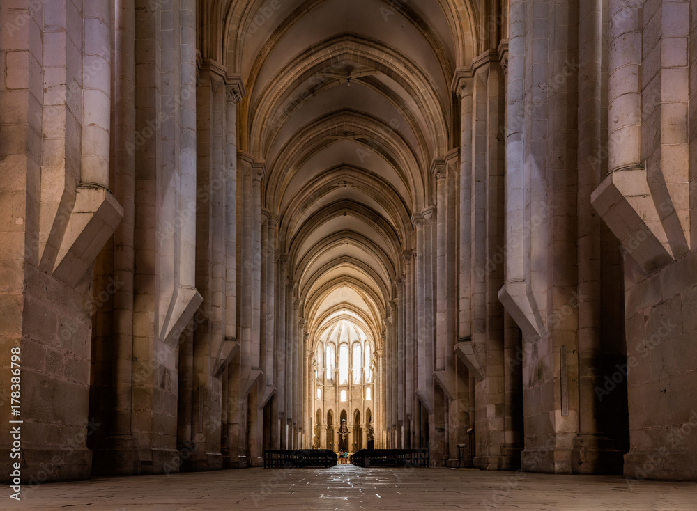 Fototapety, obrazy: View towards the main chapel and ambulatory of the medieval Alcobaca Monastery, the first truly Gothic building in Portugal, started in 1178, completed in 1252.