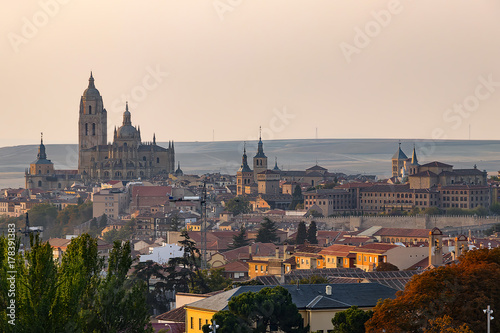 Papiers peints Madrid Panoramic view of medieval city of Segovia at sunset with the wall surrounding the old city, Spain