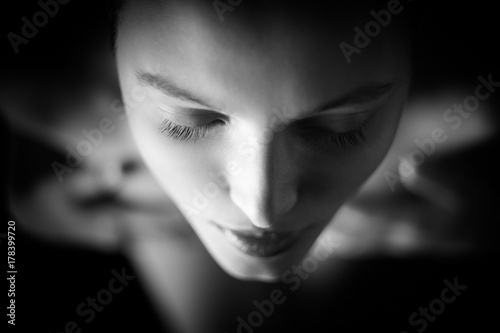 In de dag Akt beautiful young aroused nude woman with closed eyes in dark, monochrome