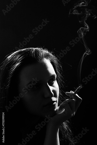 Fototapety, obrazy: beautiful woman smoking cigarette on black background, monochrome