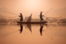 Two Fishermen Are Fishing On T...
